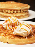 Belgian waffles with ice-cream and syrup. On white plate Stock Photography