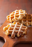 Belgian waffles with icing sugar Royalty Free Stock Images