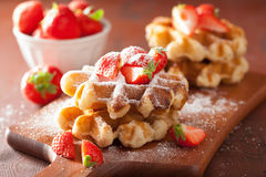 Belgian waffles with icing sugar and strawberry Royalty Free Stock Photography