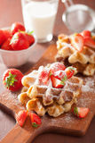 Belgian waffles with icing sugar and strawberry Stock Images