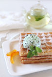 Belgian waffles with Mint Chocolate Chip Ice Cream and mint tea. Focus selective Stock Photo