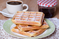 Belgian waffles with powdered sugar. On the plate Stock Photography