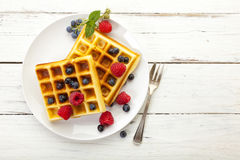 Belgian waffles with rasberries and blueberries, top view Stock Photography