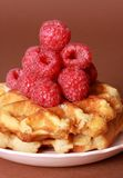 Belgian waffles and raspberries Stock Photography