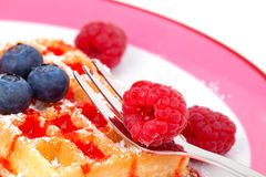 Belgian waffles with raspberries Stock Photos