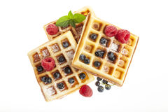 Belgian waffles with raspberries and blueberries isolated Royalty Free Stock Photography