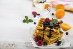 Belgian waffles with raspberries, blueberries and mint, covered Stock Photography