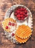 Belgian waffles with raspberries Stock Photos