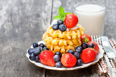 Belgian  waffles with ricotta and berries on wooden table Stock Photography