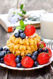 Belgian  waffles with ricotta and berries on wooden table Royalty Free Stock Photo