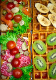 Belgian waffles with salami, green salad, tomatoes, champignon mushrooms, olives and kiwi. Breakfast, selective focus Stock Photos