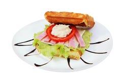 Belgian waffles sandwich with melted cheese and ham. Sandwich Belgian waffles with melted cheese, ham, tomato ringlet, isolated image on white background Stock Photography