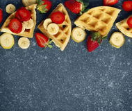 Belgian waffles with strawberries, banana and maple syrup. With copy space stock photos