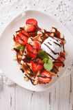 Belgian waffles with strawberries and chocolate topping. vertica Royalty Free Stock Images