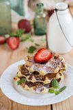 Belgian waffles with strawberries Stock Images