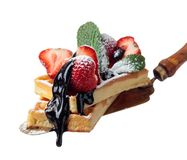Belgian waffles with strawberries, mint and chocolate  isolated on white royalty free stock images
