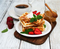 Belgian waffles with strawberries and mint Royalty Free Stock Photos