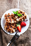 Belgian waffles with strawberries, mint, sugar powder and chocol Stock Image