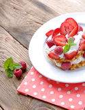 Belgian waffles with strawberries,raspberries and cream stock images