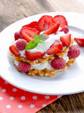 Belgian waffles with strawberries,raspberries and cream royalty free stock photography