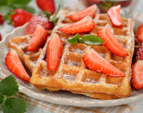 Belgian waffles with strawberries Royalty Free Stock Photos