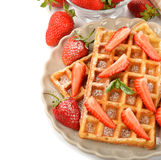 Belgian waffles with strawberries Royalty Free Stock Image