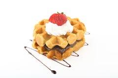 Belgian waffles strawberry and cream. Belgian waffles with strawberry and  cream white background Stock Images