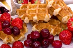 Belgian Waffles,  Summer Fruit and Maple Syrup Royalty Free Stock Image