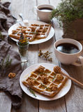 Belgian waffles sweet healthy dessert with honey, nuts, coffee, herbs. Royalty Free Stock Photos