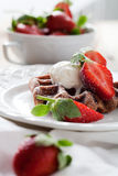 Belgian waffles. With vanilla ice cream and strawberries Royalty Free Stock Photos