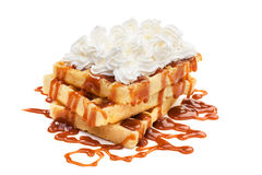 Belgian waffles. Belgian waffels under the caramel topping with cream on top Royalty Free Stock Image