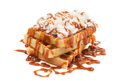 Belgian waffles. Belgian waffels under the caramel topping with cream on top Royalty Free Stock Images