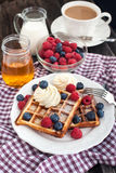 Belgian waffles with whipped cream and fresh berries Royalty Free Stock Photos