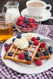Belgian waffles with whipped cream and fresh berries Royalty Free Stock Photo