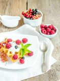 Belgian waffles with whipped cream and fresh berries Stock Photo