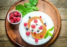 Belgian waffles with whipped cream and fresh berries Royalty Free Stock Images