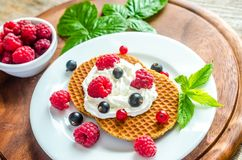 Belgian waffles with whipped cream and fresh berries Stock Photos