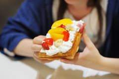 Belgian waffles with whipped cream and fruit Stock Photo