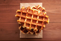 Belgian waffles on a wooden table royalty free stock photos