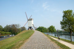 Belgian windmill by a canal Royalty Free Stock Photography