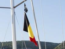 Belgien och piratkopierar flaggan Arkivbilder