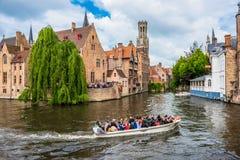 Boats full of tourist enjoying Bruges royalty free stock photo