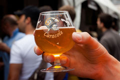 BELGIUM, BRUSSELS - SEPTEMBER 07, 2014: Belgian Beer Weekend 2014. The most famous beer festival in Belgium. Glass of Caracole beer at the festival Royalty Free Stock Images