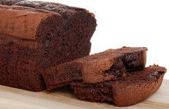 Belgium chocolate cake loaf focus on slice. Isolated belgium chocolate cake loaf focus on slice with white background royalty free stock image