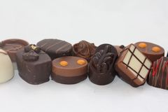 Belgium chocolates in a row Royalty Free Stock Images