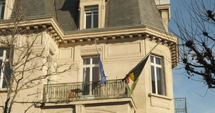 Belgium embassy flag half-mast to pay tribute. STRASBOURG, FRANCE - NOV 14, 2015: Belgium embassy flag half-mast to pay tribute to the victims of the attacks in stock video