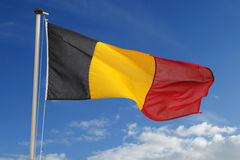 Belgium flag. Flag of Belgium fluttering against a cloudy blue sky Royalty Free Stock Images