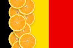 Belgium flag and citrus fruit slices vertical row. Belgium flag and vertical row of orange citrus fruit slices. Concept of growing as well as import and export stock illustration