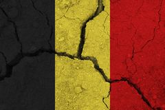 Belgium flag on the cracked earth. National flag of Belgium. Earthquake or drought concept royalty free stock photo
