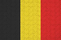 Belgium flag is depicted on a folded puzzle stock illustration
